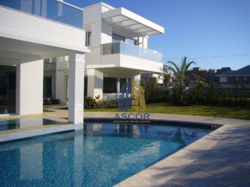 Excelente casa de alto padrão em Jurerê Internacional. 4 suites, 7 banheiros, garagem para 4 carros, Florianópolis. CA0035
