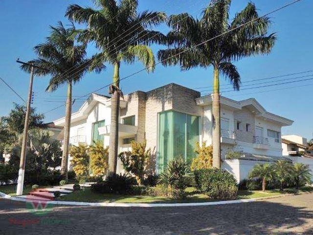 Sobrado à venda no Jardim Acapulco em Guarujá, 7 suítes e lazer