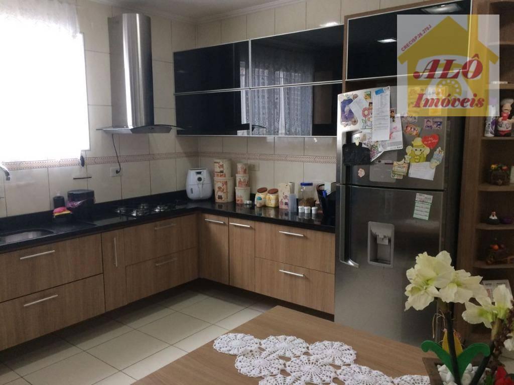 Sobrado com 3 dormitórios à venda, 286 m² por R$ 570.000,00 - Santa Maria - Santos/SP
