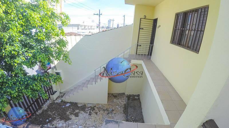Casa com 3 dormitórios para alugar, 180 m² por R$ 1.500,00/mês - Vila Guilhermina - Praia Grande/SP