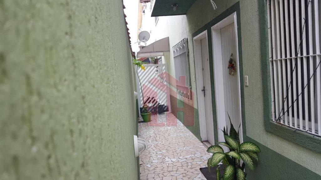 Sobrado residencial à venda, Vila Voturua, São Vicente.