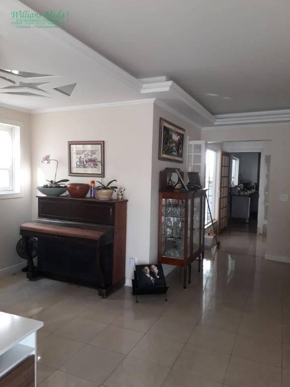 Sobrado 4 dormitórios, 4 vagas cobertas, Parque Santo Antônio, Guarulhos.
