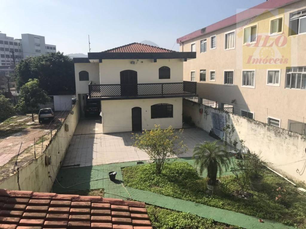 Sobrado com 3 dormitórios à venda, 350 m² por R$ 1.200.000 - Vila Guilhermina - Praia Grande/SP