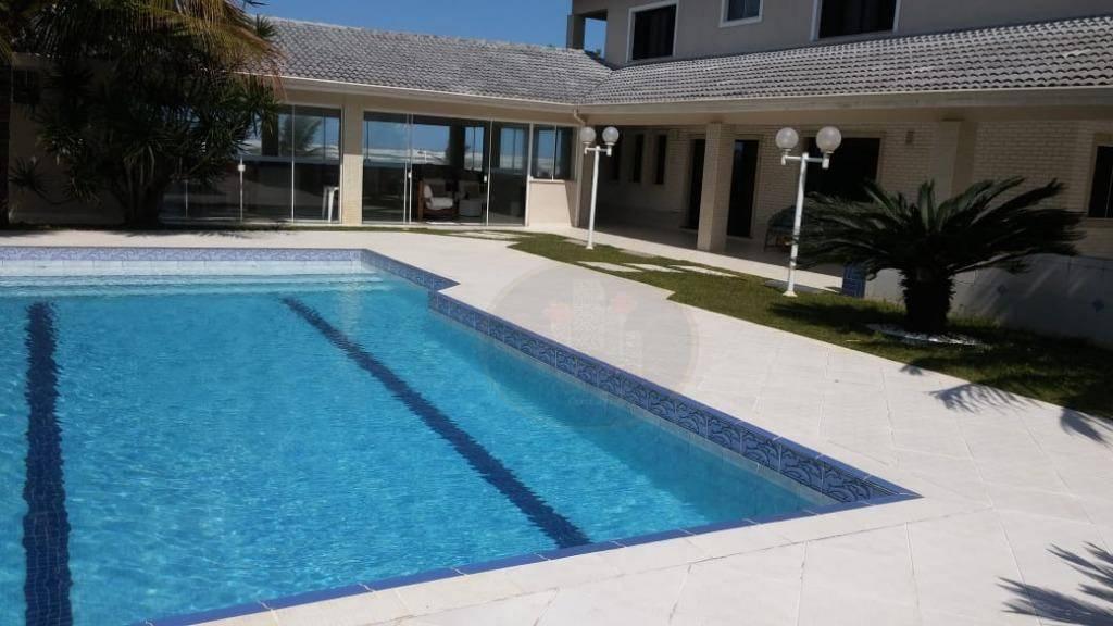 Casa com 5 dormitórios à venda, 500 m² por R$ 3.590.000,00 - Bougainvillee I - Peruíbe/SP